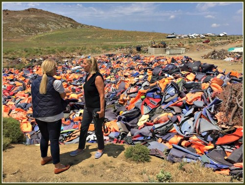 Robin Tauck (right) surveys some of the hundreds of thousands of abandoned life jackets.