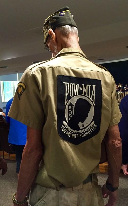 A Vietnam veteran stands silently in the Town Hall lobby. (Photo/Doris Ghitelman)