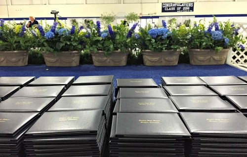 483 diploma covers sat on tables in the fieldhouse. Each graduate received one. The actual diplomas came later.