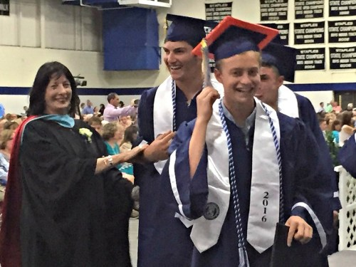 Grant Sirlin (right) and friends accept congratulations from assistant principal Karyn Morgan.
