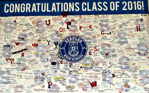 On the way to the fieldhouse, guests passed a large board on which graduates listed their post-high school plans.