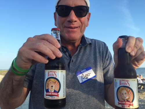 "Bart Shuldman brought a pair of dueling beverages: Trump Tonic (""Make America grape again"") and Hillary Hooch (""classified flavor"")."