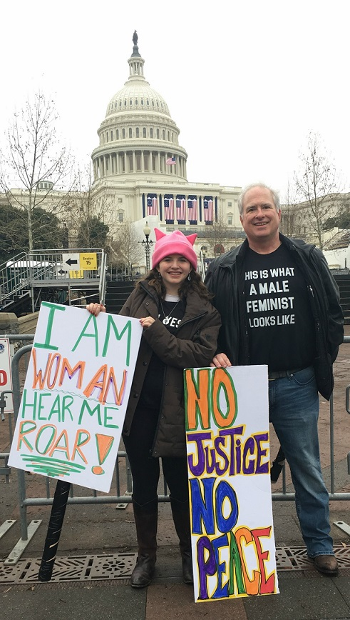 The women's march welcomed all genders. This is longtime Westporter John Suggs and his 14-year-old daughter Rachel.
