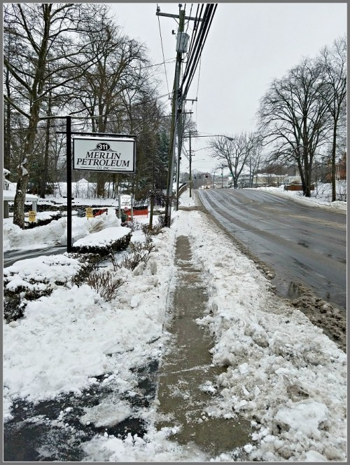 The section of Post Road sidewalk that was cleared, cleared again, then partly covered by plowed snow. (Photo/Adrian Little)