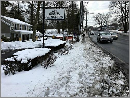 snow-on-sidewalk-post-road