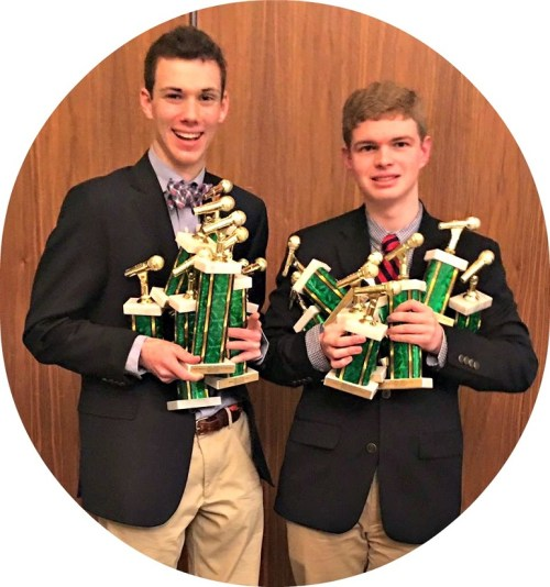 Cooper Boardman (left) and Jack Caldwell, with their 14 trophies.
