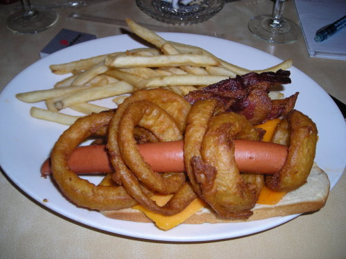 The Lord of the Rings Foot long hot dog threaded through onion rings, served with cheese and bacon on top. (submitted by Kristin Brammell via Pink's Las Vegas)
