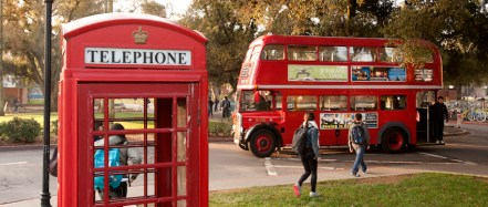 A vintage London double-decker Unitrans bus pulls into the UC Davis Memorial Union Terminal bus station on Monday, January 7, 2013. A British red telephone booth is in the foreground.