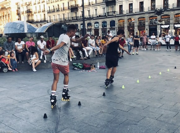 Madrid, Spain, Stunt, city, europe, iberia, motion, people, puerta del sol, roller, rollerbladers, rollerblading, spanish, sport, square, street