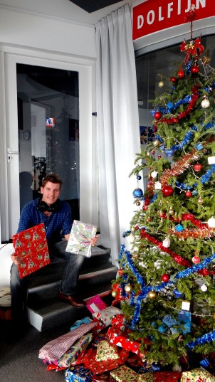 Maarten surrounded by gifts.