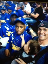 Baby Justin Salas Pender couldn't stop pointing at the Little League Liga Pariba team as they marched into the Florida Marlins stadium proudly waving #Curacao's flag... [Baby Justin's mom, Suzanne Salas, is 100% Yu di Kòrsou]