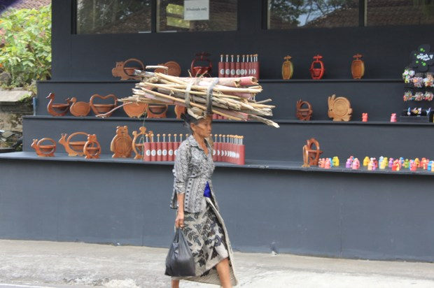 woman with wood on head
