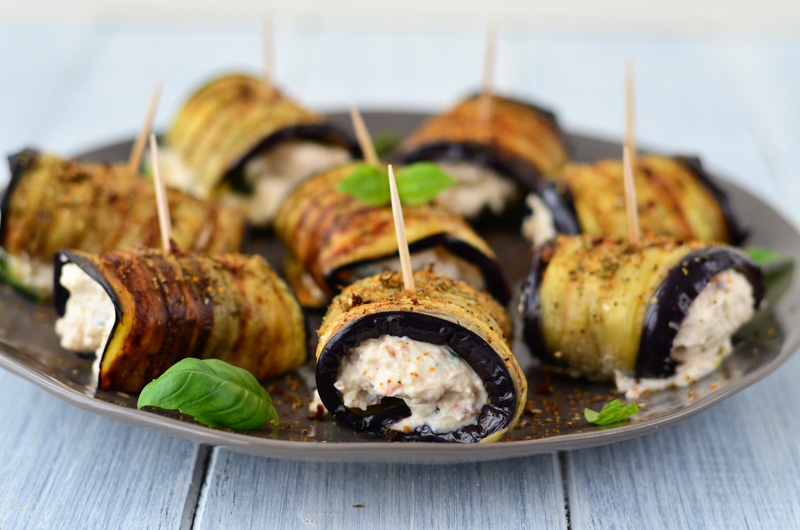 Grilled Aubergine and Courgette Rolls filled with a mixture of cheese, sundried tomatoes, lemon, and basil are ideal as a summer vegetarian appetizer.
