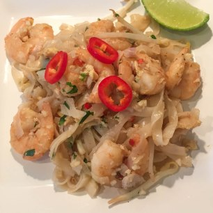 A photo of the finished Pad Thai dish served on a white plate and ready to eat