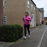 A photograph of Emma running on the final leg of her final run.