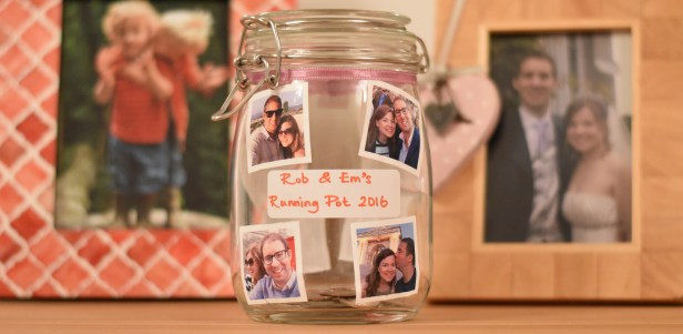 A photograph of Rob and Emma's pot which will gain £1 for each run that Emma and Rob complete in 2016. It has four photos of Emma and Rob stuck on the side, for no other reason than to make them smile.