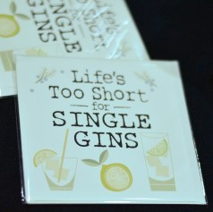"""A photograph of cards for sale with the slogan """"Life's too short for single gins"""""""