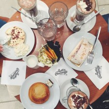 A top-down photograph of a table at Butler's Chocolate Cafe in Dublin. Emma and her two friends had hot chocolate and cake!