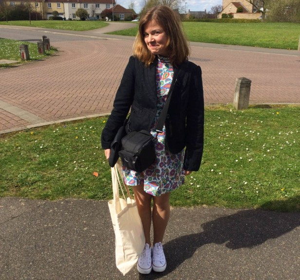 A photograph of Emma ready to walk to the Poets House. She's wearing Converse trainers for the walk, rather than heels!