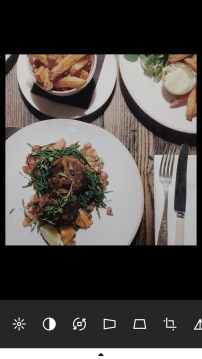 A screenshot of VSCO on Emma's phone showing the editing features and a photograph of Emma's meal at the Old Bicycle Shop in Cambridge