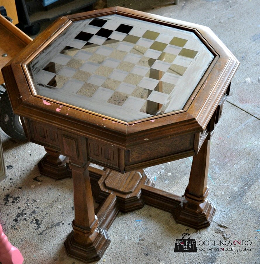 octagonal table with chess board etched into the glass