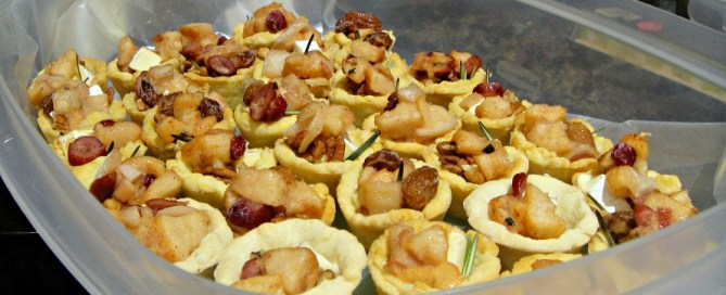 A dozen plus pear tartlets packaged up and ready to go in the freezer