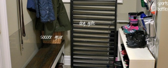 Organized mudroom with shoe shelves coat hooks and a bench for seating