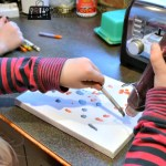 Melting crayons onto canvas to create one-of-a-kind art