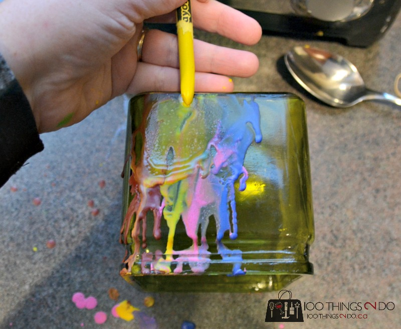 Melting crayons over a vase