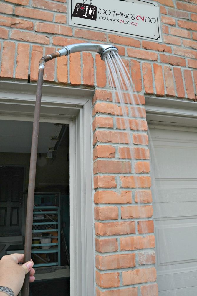 DIY Watering wand - made from a shower head, pipe and an outdoor faucet!