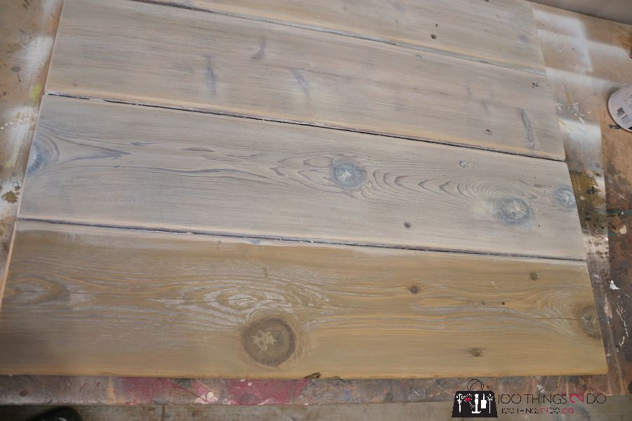 applying a white wash solution to wood
