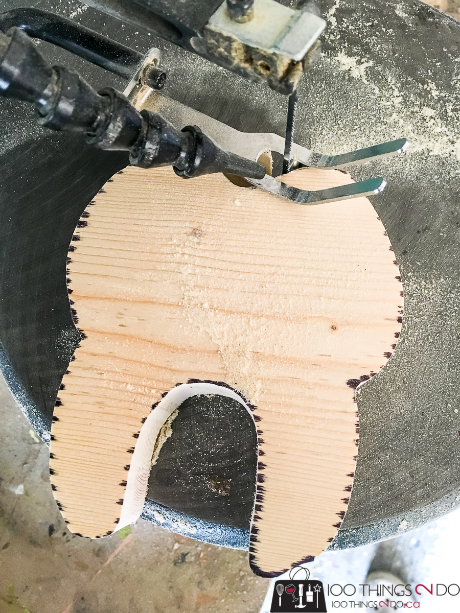 scroll saw cutting a tooth silhouette