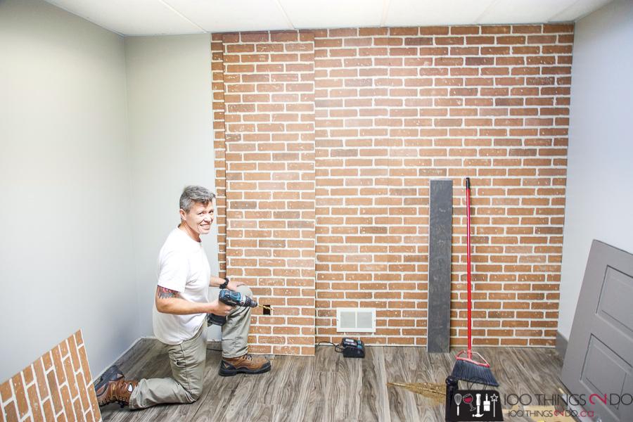 Details Renovations installing faux brick wall