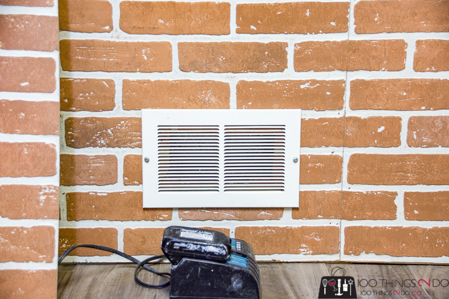 cold air return vent in a faux brick wall