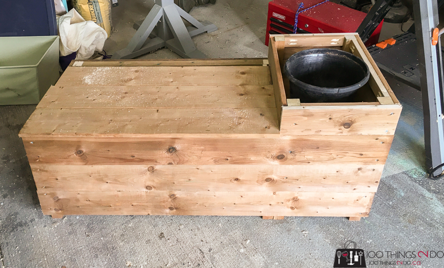 Lid on porch planter bench