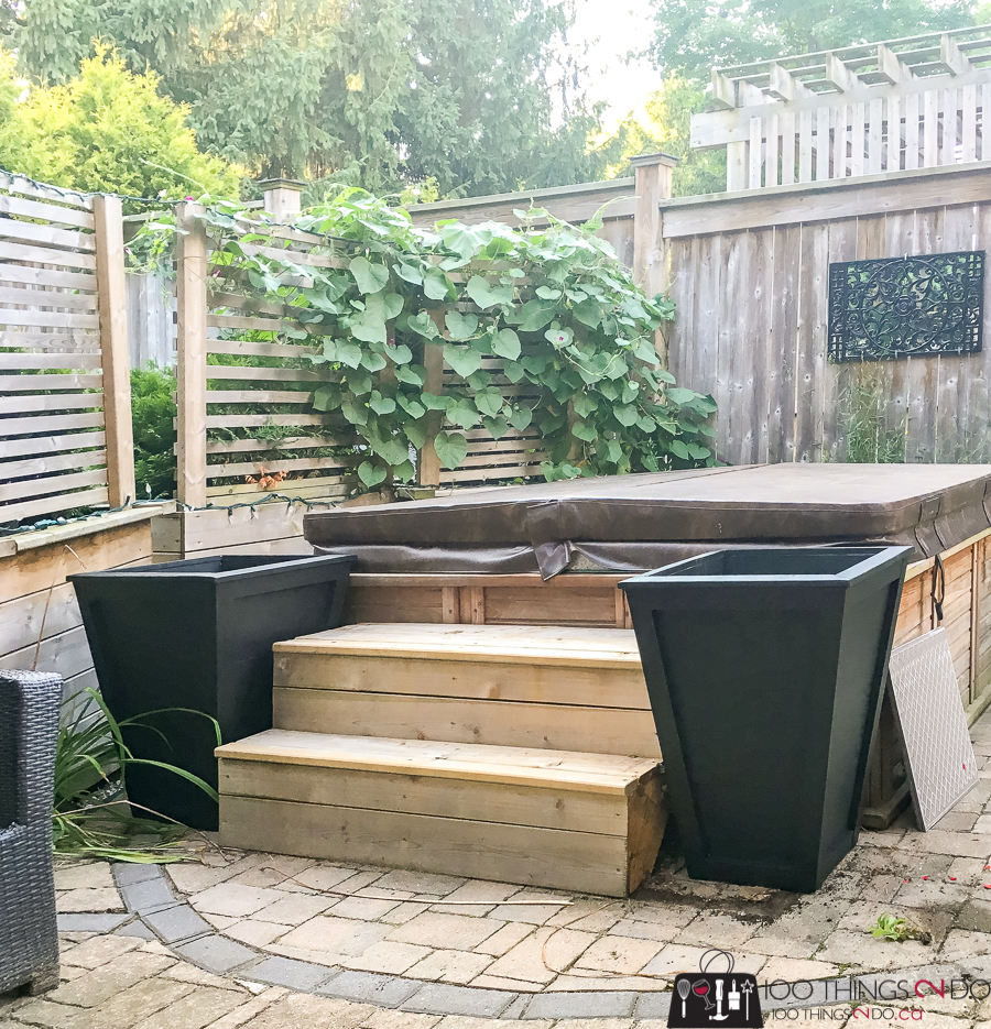 hot tub stairs flanked by planters