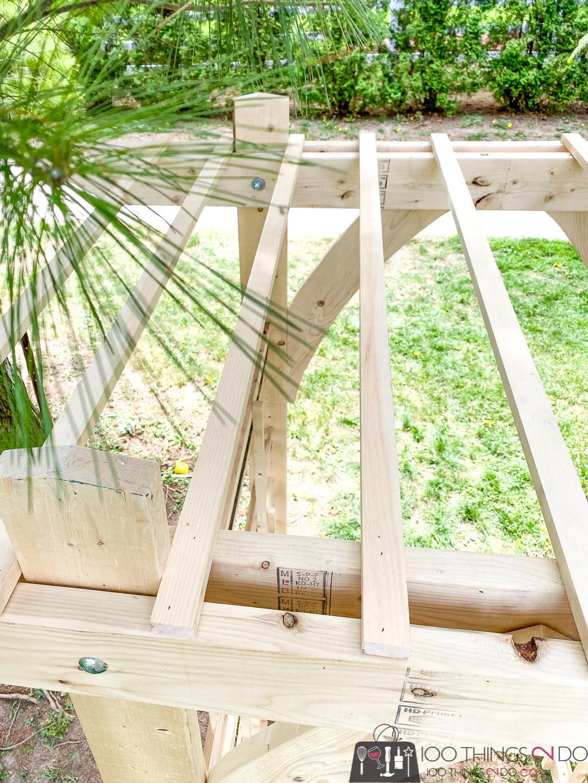 adding a trellis to a garden arbour