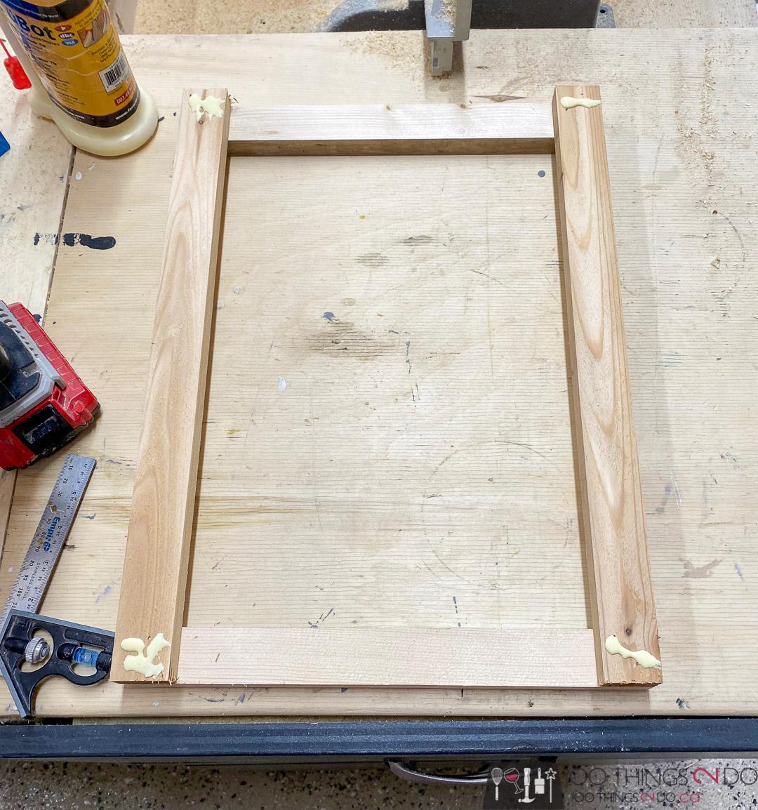 gluing slats on a patio side table