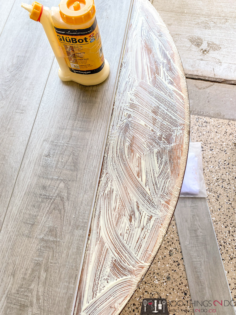 applying laminate flooring to a card table