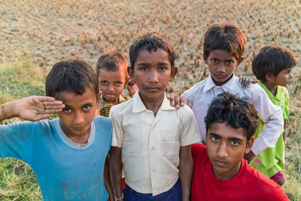 Children posing in the field