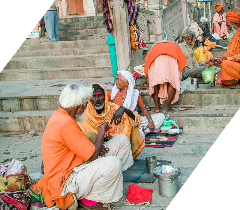 Varanasi beggars sitting on steps by River Ganges