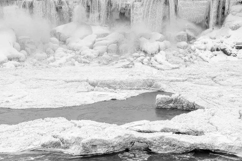 The icy sculptures formed by the polar vortex at the base of the small American Falls