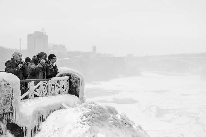 Tourists taking photos of the Horseshoe Falls, Niagara Falls, Canada