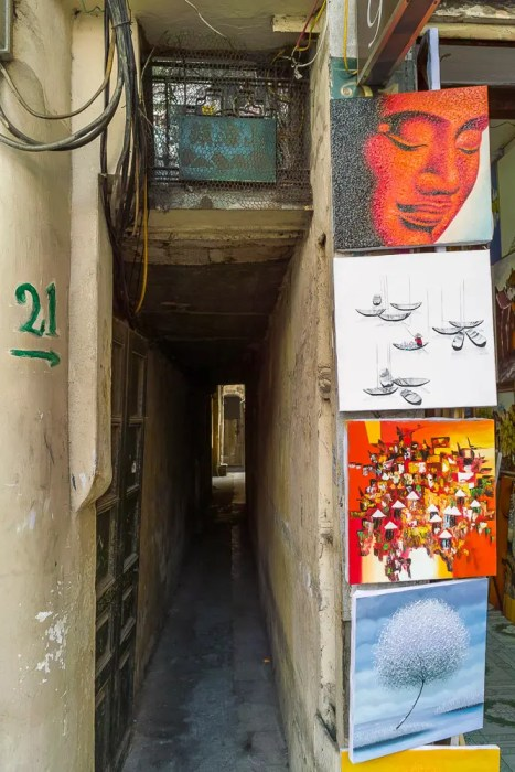 Narrow passage and paintings