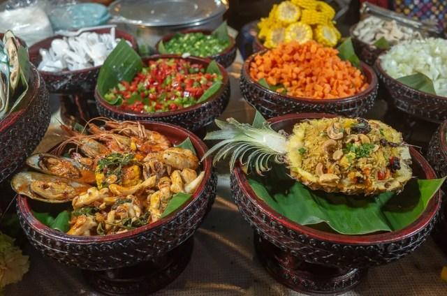 Pineapple fried rice and stir fried seafood