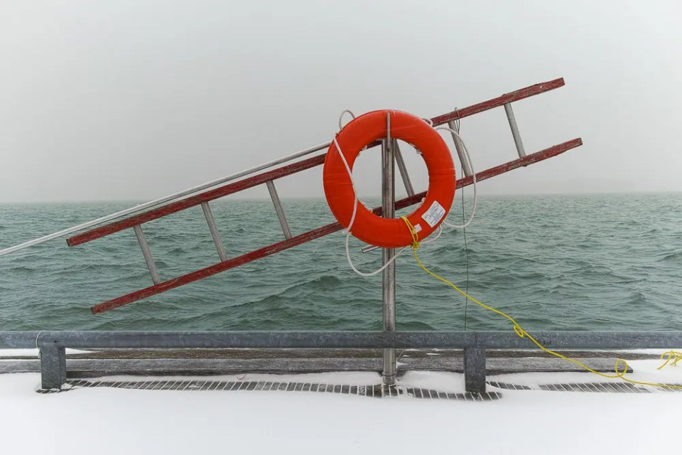 Ring buoy and ladder in the winter