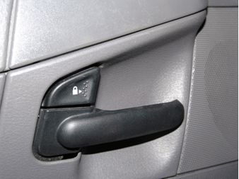 in removing the door panel the first step is to remove the interior door  handle trim panel  at the forward edge insert a small flat prying tool and  release