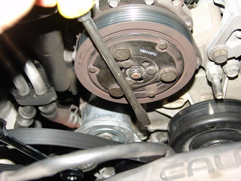 Once the nut is removed the clutch hub can be removed firmly grasp the edges of the clutch hub and with a wiggling back and forth motion pull the clutch