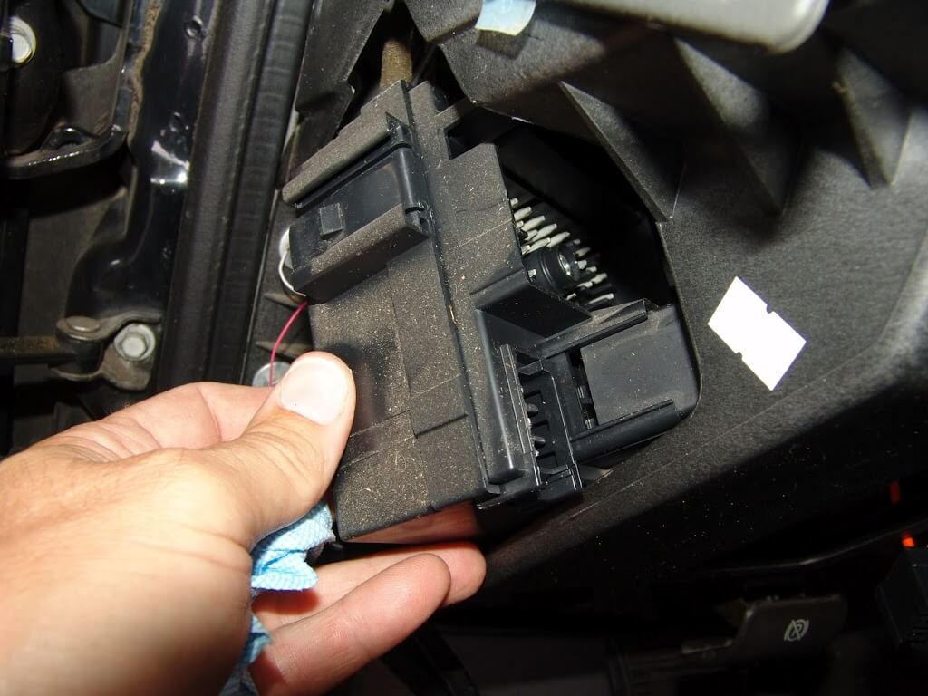 Sparkys Answers Chevrolet Silverado Blower Does Not Work On Any Speed Picture Of2012 Fuse Box Chevy Equinox There Are A Couple Of Latches That Have To Be Released Remove The From Its Mounting Bracket You Can See One Above My Thumb In
