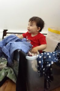"""My son, """"helping out"""" with the clothes declutter."""